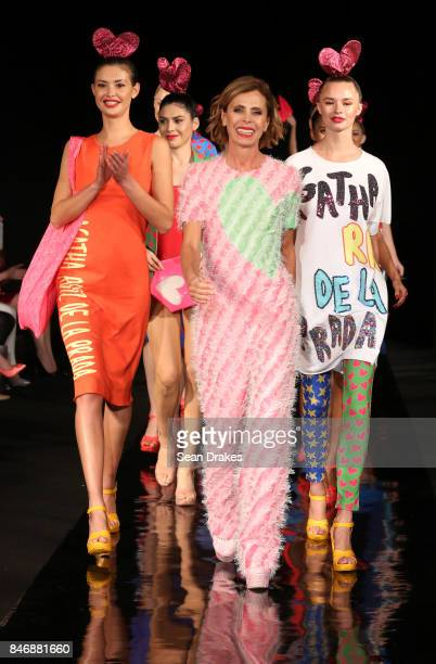 Womenswear designer Agatha Ruiz De La Prada of Spain poses with models in the Fashion Designers of Latin America collection shows during New York...