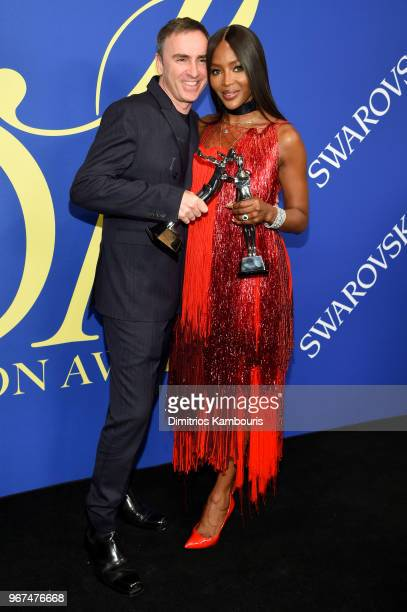 Womenswear Designer of The Year Raf Simons and 2018 CFDA Fashion Icon Naomi Campbell attend the 2018 CFDA Fashion Awards Winners Walk at Brooklyn...