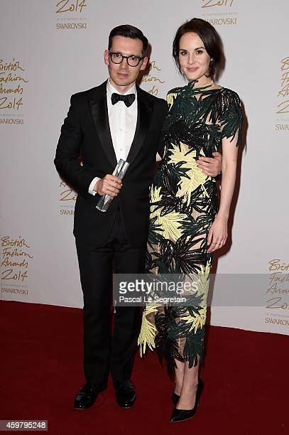 Womenswear winner designer Erdem Moralioglu and Michelle Dockery pose in the winners room at the British Fashion Awards at London Coliseum on...