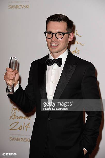 Womenswear winner designer Erdem Moralioglu poses in the winners room at the British Fashion Awards at London Coliseum on December 1 2014 in London...