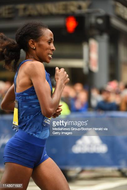 Womenu2019s runnerup Edna Kiplagat tries in vain to close on Worknesh Degefa on Boylston St during the 123rd Boston Marathon on Monday April 15 2019...