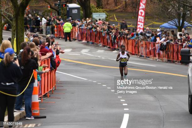 Womenu2019s winner Worknesh Degefa strides along the course of the 123rd Boston Marathon on Monday April 15 2019 in Boston Massachusetts