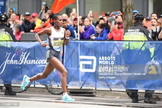 Womenu2019s winner Worknesh Degefa strides down Boylston St during finish of the 123rd Boston Marathon on Monday April 15 2019 in Boston Massachusetts