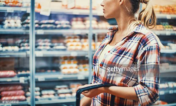 Womkan in supermarket.