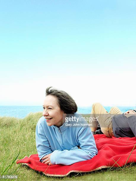 womn enjoys the breeze  - king's lynn stock pictures, royalty-free photos & images
