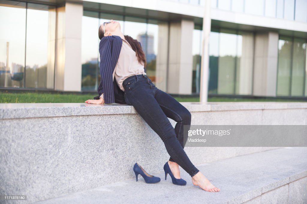 Womаn in high heels having a rest : Stock Photo