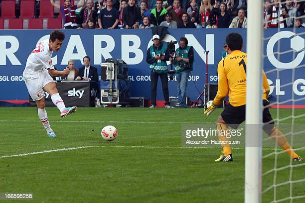 Won Dong Ji of Augsburg scores the second team goal against Oka Nikolov keeper of Frankfurt during the Bundesliga match between FC Augsburg and...