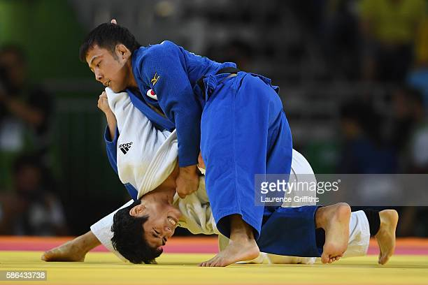 Won Jin Kim of Korea competes with Naohisa Takato of Japan during the men's 65kg contest on Day 1 of the Rio 2016 Olympic Games at Carioca Arena 2 on...