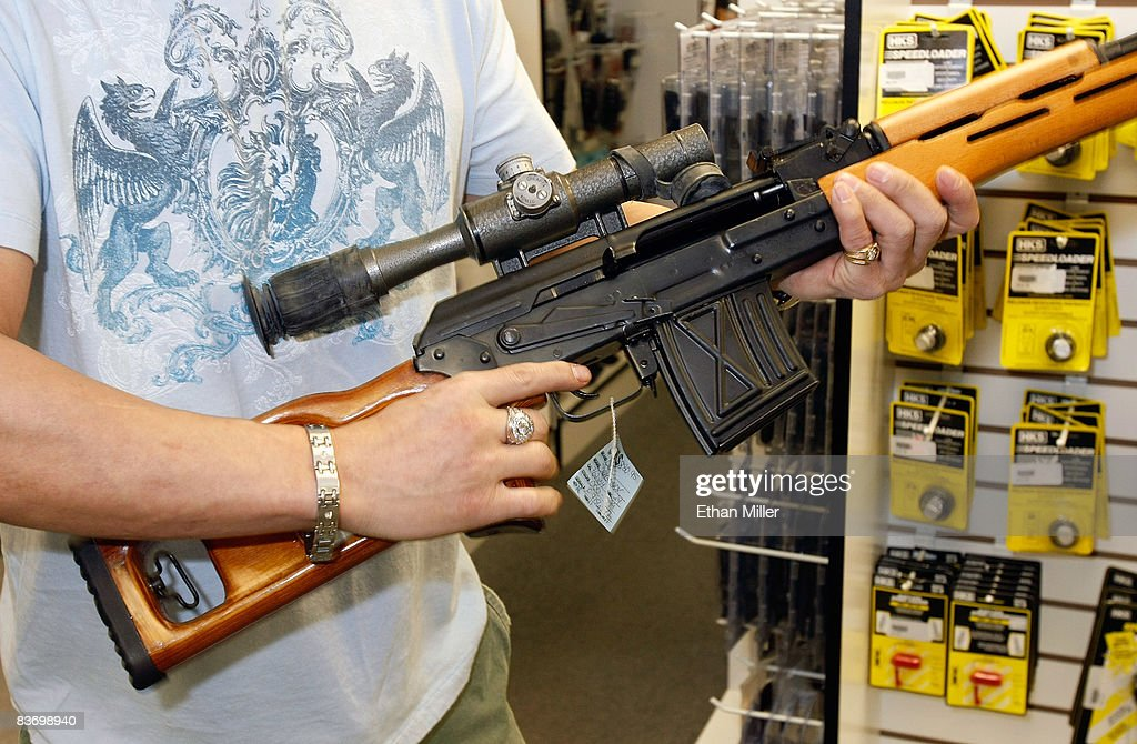 Won Kim (R) of Nevada examines a rifle at The Gun Store November 14, 2008 in Las Vegas, Nevada. Store manager Cliff Wilson said he's seen a large spike in sales since Barack Obama was elected president on November 4, with customers citing fears about the president-elect's record on firearms. The election, combined with a slumping economy, has contributed to an overall increase of 25-30 percent in gun sales at the store, Wilson said.