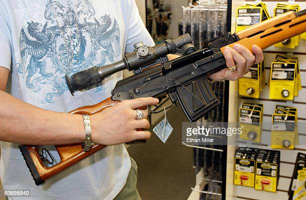 Won Kim of Nevada examines a rifle at The Gun Store November 14 2008 in Las Vegas Nevada Store manager Cliff Wilson said he's seen a large spike in...