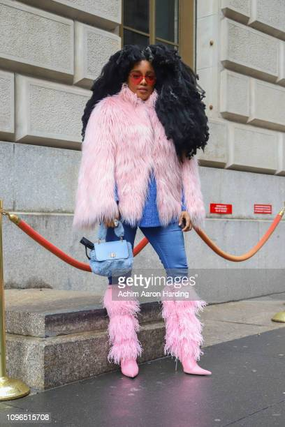 Wonder is seen wearing a pink coat blue bag and pink boots on the street during New York Fashion Week on February 8 2019 in New York City