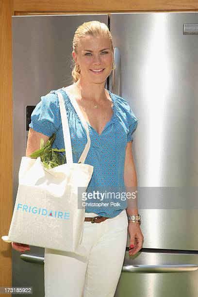 Wonder mom Alison Sweeney does the perfect balancing act as she manages a full bag of groceries in one hand while organizing the refrigerator with...
