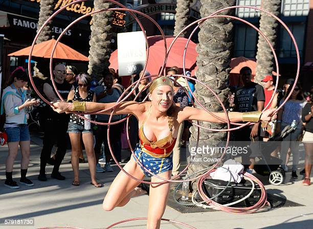 Wonder Woman cosplayer performs with hula hoops at ComicCon International on July 22 2016 in San Diego California