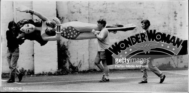 Wonder woman for Float in Mardi Gras parade ... Susan Hampton Cath Phillips and Joan Carter with sign.The Mardi Gras has traditionally been a...