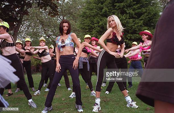 Wonderbra model Adriana Karembeu and American Wonderbra Bliss model Michelle Ray wearing customised Wonderbras excercising before the walk