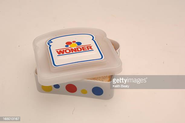 Wonderbread sandwich container. Fancy lighter. One-piece measuring cup and spoon set. Four kinds of Napoleon Dynamite breathmints. Grape and lime...
