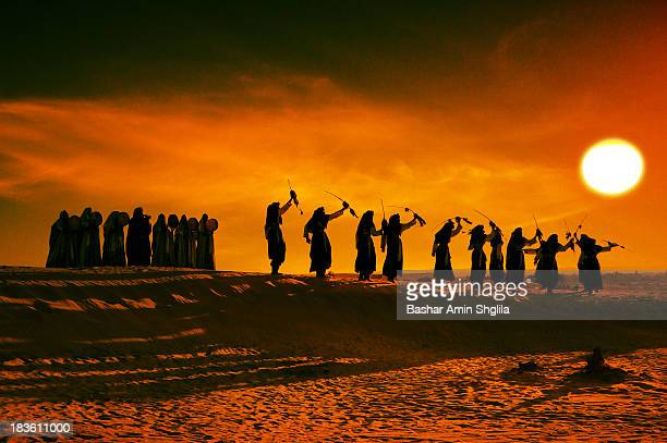 Wonderful atmosphere at Libyan desert with the voice of singers & the sounds of the music during the festival of Tuareg at El-Berkit Village, Libya
