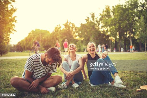 wonderful friendship time - public park stock pictures, royalty-free photos & images