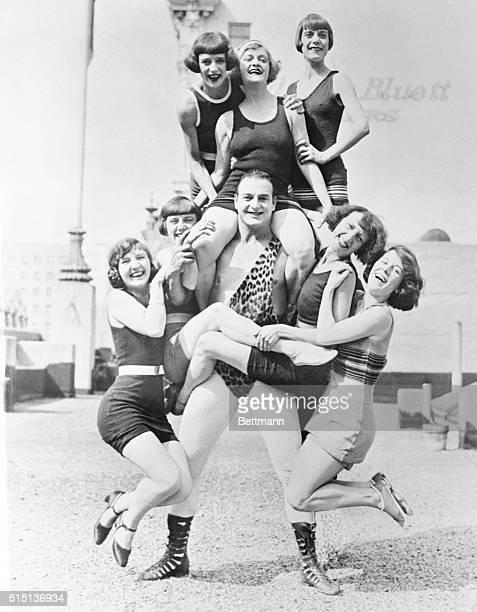 Wonderful Handler of the Ladies: Los Angeles, California: Photo shows Bonomo, world's strongest human, as he bears seven bathing girls between scenes...