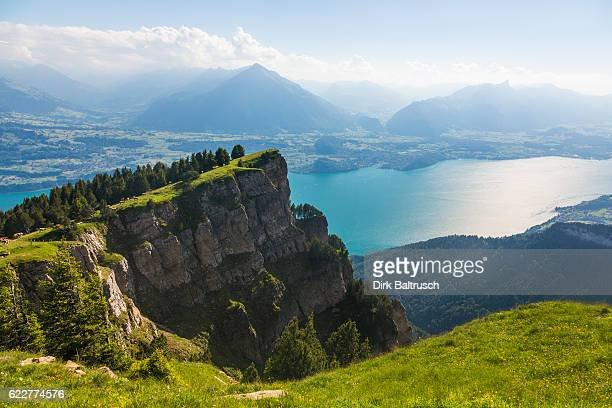 wonderful panoramic view over lake thunersee just before sunset - swiss alps stock pictures, royalty-free photos & images
