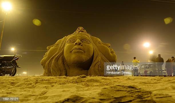 A wonderful sand statue symbolizing Sangam the confluence of Ganga Yamuna and mythical Saraswati erected at Sangam on January 9 2013 in Allahabad...