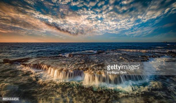 Wonderful seascape at Nui Chua national park, Ninh Thuan, Viet Nam, waves on large rock and make amazing fall in Hang Rai at sunrise, amazing landscape at Vietnam beach, masterpiece place for travel