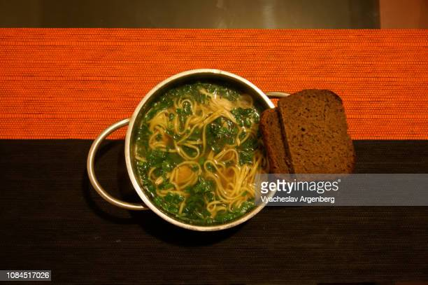 a wonderfully warming noodle soup on red/black background - rostov on don stock pictures, royalty-free photos & images