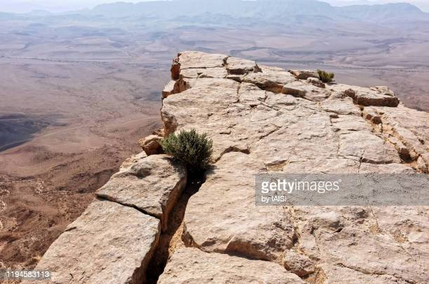 wonders of the world, directly above makhtesh ramon in the negev desert, vertigo - rock formation stock pictures, royalty-free photos & images