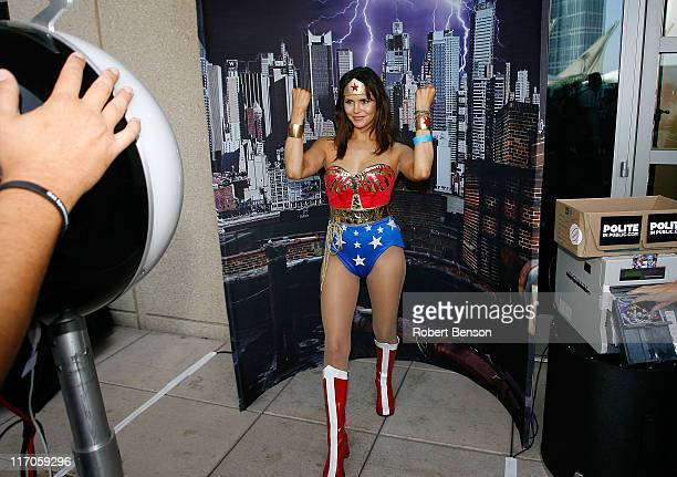 A Wonderwoman fan poses in the Havaianas photo booth at the WIRED Cafe at ComicCon at The Omni on July 25 2009 in San Diego California