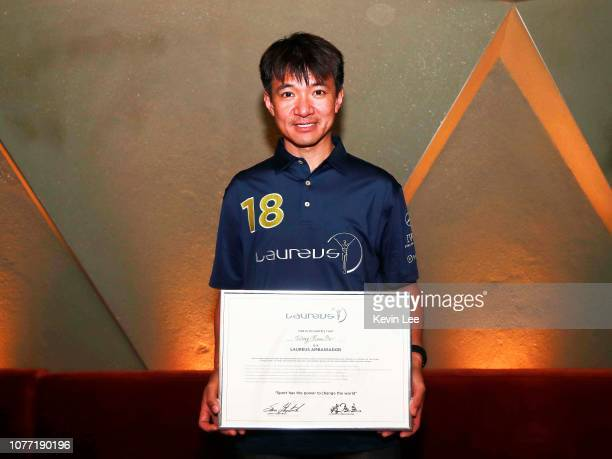 Wong Kam Po poses with the certificate before the Laureus Hong Kong Ambassador Announcement ceremony at Mercedes Me Store on December 04 2018 in Hong...