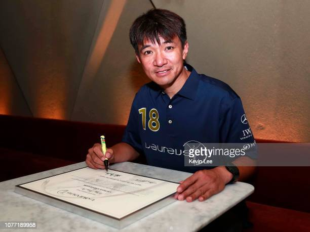 Wong Kam Po signs the certificate before the Laureus Hong Kong Ambassador Announcement ceremony at Mercedes Me Store on December 04 2018 in Hong Kong...
