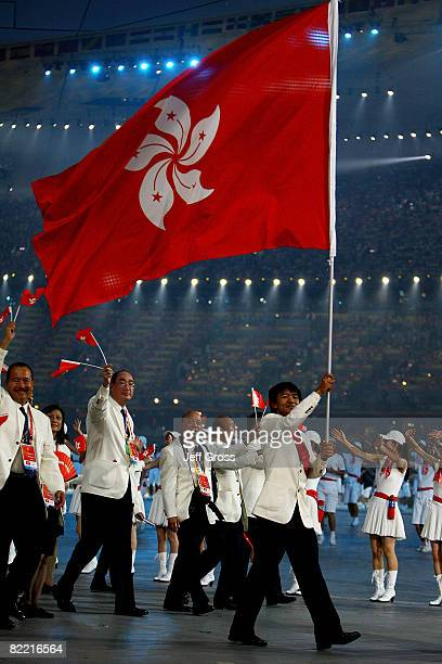 Wong Kam-Po of Hong Kong China carries his country's flag during the Opening Ceremony for the 2008 Beijing Summer Olympics at the National Stadium on...