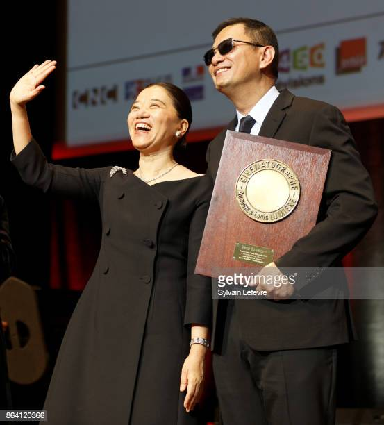Wong Karwai and his wife Yecheng Chan attend The Lumiere Prize ceremony during 9th Film Festival Lumiere on October 20 2017 in Lyon France