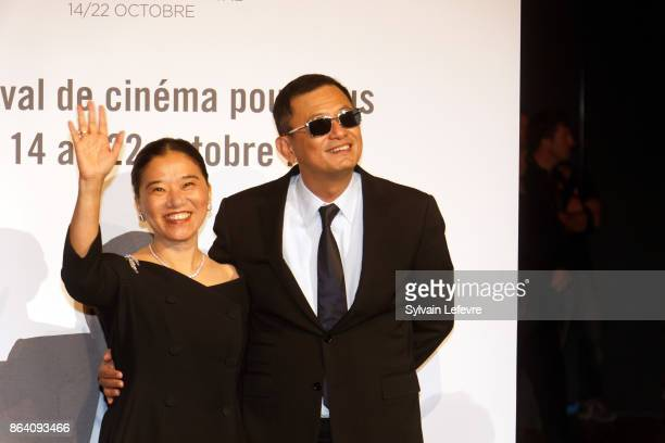 Wong Karwai and his wife Yecheng Chan attend the photocall before The Lumiere Prize ceremony during 9th Film Festival Lumiere on October 20 2017 in...