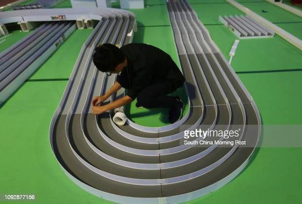 Wong Tszshing volunteer of Maker Faire builds mini 4WD car race tracks for Maker Faire at Poly University in Hung Hom 07APR17 SCMP / Xiaomei Chen