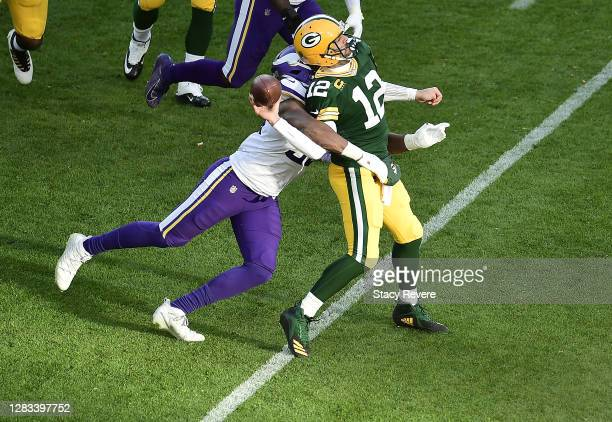 Wonnum of the Minnesota Vikings sacks Aaron Rodgers of the Green Bay Packers during the fourth quarter to win the game at Lambeau Field on November...