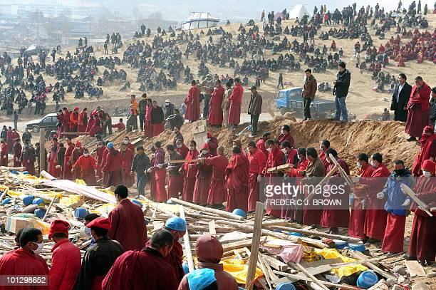 Wood and prayer flags are laid down as Tibetan Buddhist monks prepare the fire for a mass cremation on a hillside in Jiegu, Yushu County, on April...