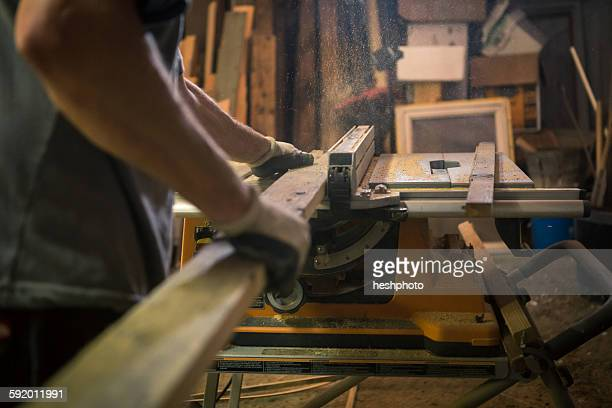 wood artist in workshop, using woodworking machinery, mid section - heshphoto stock pictures, royalty-free photos & images