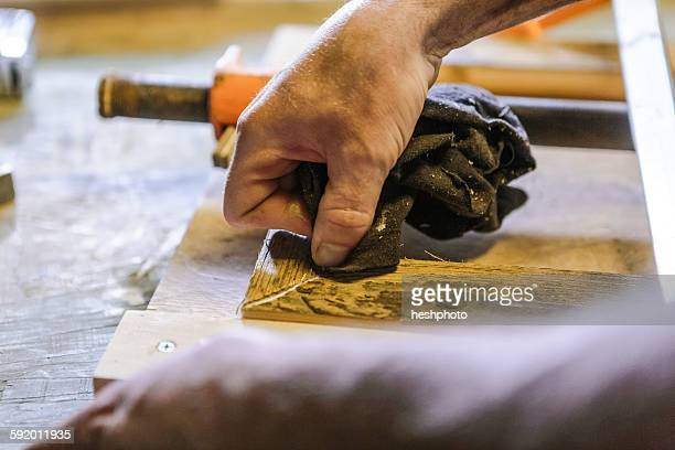 wood artist working in workshop, close-up - heshphoto stock pictures, royalty-free photos & images