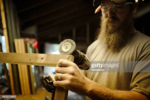 wood artist working in workshop - heshphoto stock pictures, royalty-free photos & images