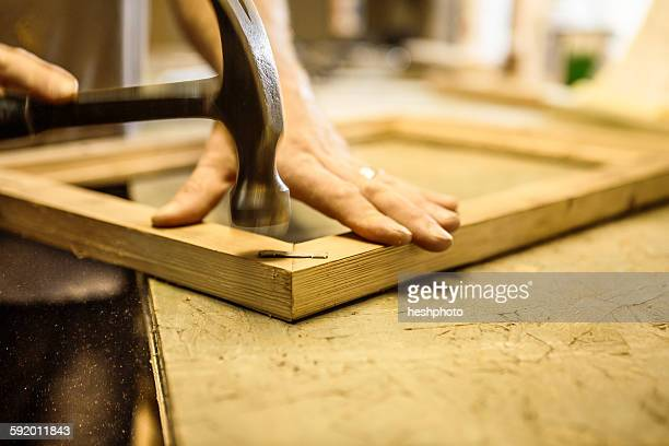 wood artist working in workshop, using hammer, close-up - heshphoto stock pictures, royalty-free photos & images