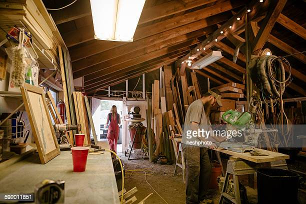 wood artists working in workshop - heshphoto stock pictures, royalty-free photos & images