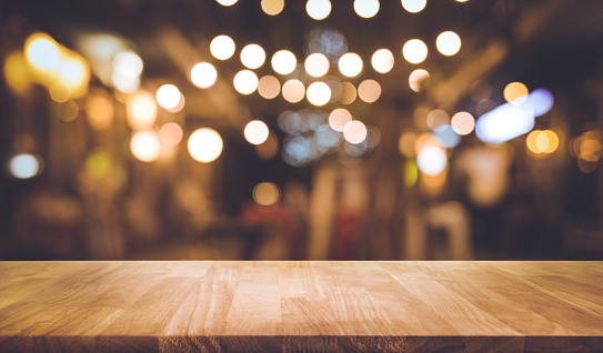 Wood bar table with blur lighting in night street cafe 888590616