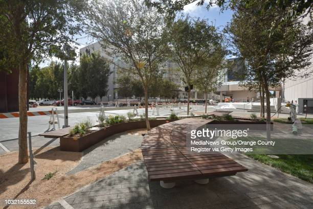 Wood benches wind their way through the new Julianne and George Argyros Plaza at the Segerstrom Center for the Arts in Costa Mesa California on...