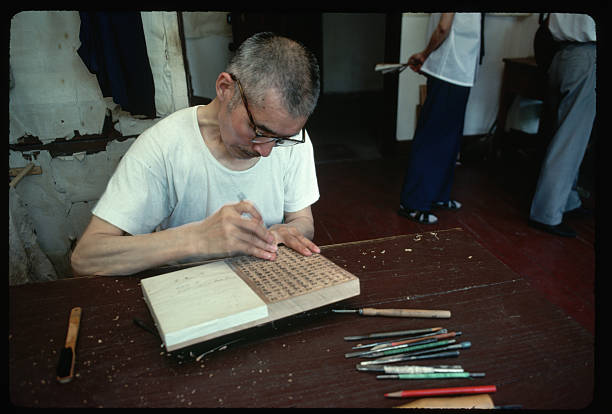 wood block carver pictures getty images