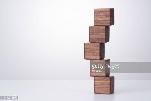 wood block stacking - toy block stock pictures, royalty-free photos & images