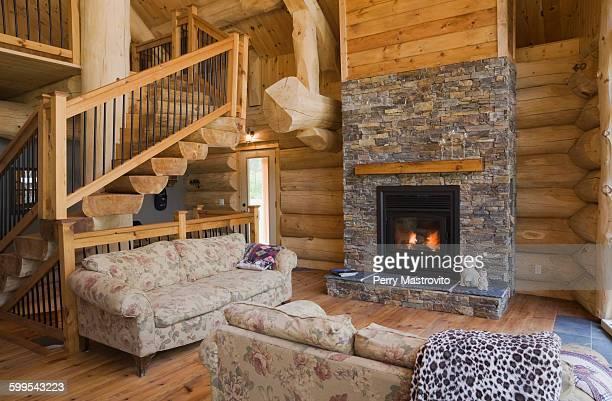 Wood burner in living room of Eastern white pine log cabin