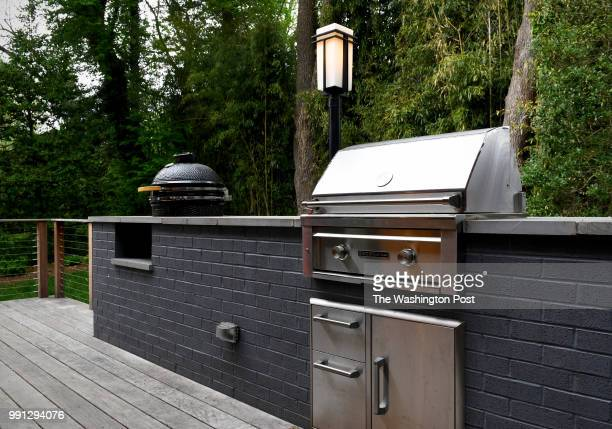 A wood burning smoker BBQ and a gas grill were added onto the deck of the Gillenwaters' home seen May 06 2018 in Kensington MD