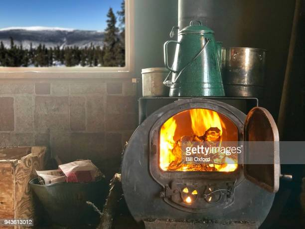 wood burning stove in cabin - wood burning stove stock photos and pictures