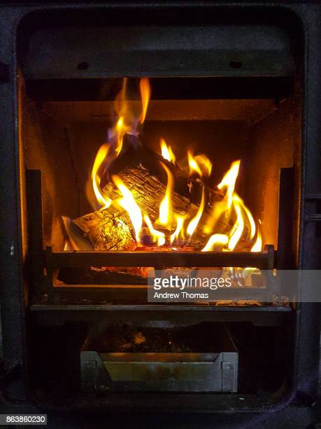 wood burning stove - wood burning stove stock photos and pictures